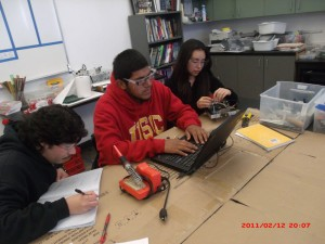 Edgar Montes is programming the robot so it can move on its own.