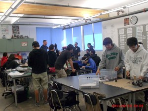 The class has begun and the robotic students are starting to construct their robots.