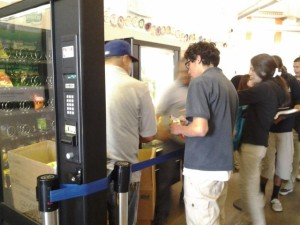 Students exchanging their money for a snack or frozen food items in the vending machines.