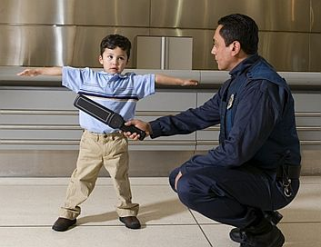 security-wand-on-kids-at-airport